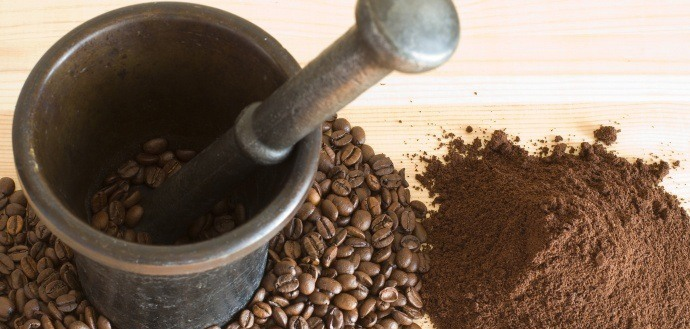 Grind-coffee-beans-with-mortar